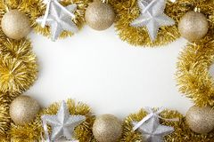 Palle dorate di Natale, stelle d'argento Fotografia Stock