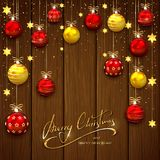 Palle e stelle di Natale su fondo di legno Immagine Stock Libera da Diritti