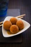 Palle fritte in grasso bollente asiatiche Fotografia Stock
