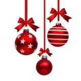 Palle rosse di Natale con l'arco Immagine Stock