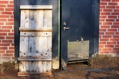 Pallet against door Stock Images