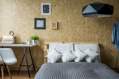 Pallet bed in contemporary interior Royalty Free Stock Image