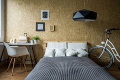 Pallet bed in ecological bedroom Royalty Free Stock Photography