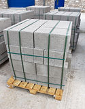 Pallet of breeze blocks. Pallets of breeze blocks at a construction site from a builders merchant known as cinder blocks in the us or Concrete masonry units royalty free stock image