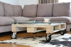Pallet coffee table in modern living room royalty free stock images