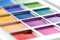 Pallet of colored eye shadows, texture. Shallow depth of field Stock Image