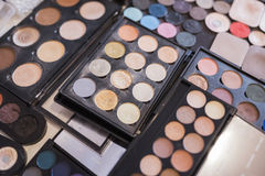 A pallet of concealer, powder and shadows. Stock Images