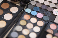Pallet of concealers and shadows on a black background Stock Photos