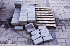 Pallet with few rows of concrete grey pavement blocks Royalty Free Stock Images