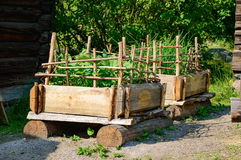 Pallet garden. Ing in the old days with timber and plank to form a pallet of sort. Vegetables are grown in soil inside the pallet and sticks of wood form Stock Photography