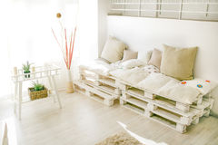 Pallet interior home behind. Pallet interior home in white pure living room Stock Photo