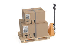 Pallet jack with cardboard box Royalty Free Stock Image