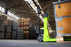 Pallet jack in the industrial hall royalty free stock photo