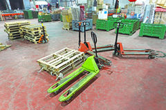 Pallet Jack. Manual Pallet Jack in shipping and distribution warehouse Stock Images