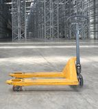 Pallet Jack in Warehouse. Pallet Jack Pump Truck in Distribution Warehouse Royalty Free Stock Photography