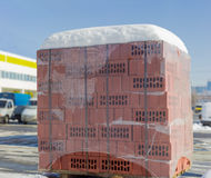 Pallet of the perforated red bricks on an outdoor warehouse Stock Photography
