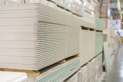 Pallet with plasterboard in the building store.  Stock Photos