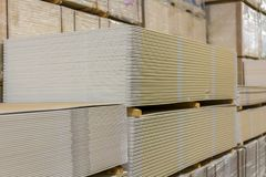 Pallet with plasterboard in the building store.  Royalty Free Stock Image