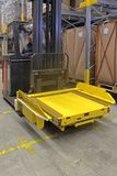 Forklift Shuttle. Pallet Shuttle Robot at Forklift in Semi Automated Warehouse stock photo