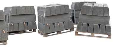 The pallet with a stack of concrete curbstone on white. Background Stock Image
