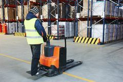 Pallet stacker truck at warehouse. Electric forklift pallet stacker truck equipment at work in warehouse Stock Photo