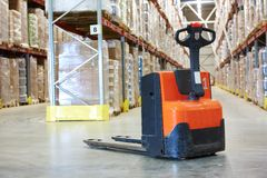 Pallet stacker truck at warehouse. Manual forklift pallet stacker truck equipment at warehouse Stock Photo