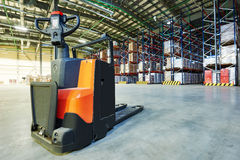 Pallet stacker truck at warehouse Royalty Free Stock Images