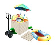 Pallet Truck Loading Beach Items in Shipping Box Royalty Free Stock Image