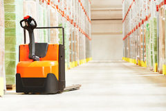 Pallet truck at warehouse Stock Photography