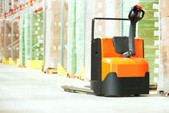 Pallet truck at warehouse Stock Photo