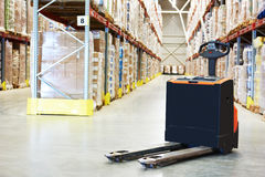 Pallet truck at warehouse Royalty Free Stock Image
