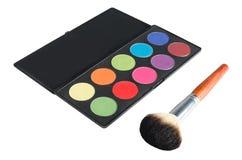Pallete and brush. Makeup pallete and big makeup brush Royalty Free Stock Photo