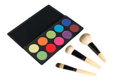Pallete and brushes. Makeup pallete and three brushes stock images