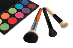 Pallete and brushes. Makeup pallete and three brushes Stock Photo