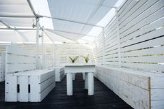 Pallete furniture ideas. Industrial palletes furniture painted in white for beach bar,fantastic idea stock image