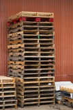 Pallets against Barn 1. Pallets in Rochester with different colors royalty free stock image