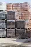 pallets with bricks in the building store. Racks with brick. Masonry, stonework. stock images