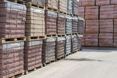 pallets with bricks in the building store. Racks with brick. Masonry, stonework. stock image