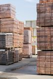 pallets with bricks in the building store. Racks with brick. Masonry, stonework. royalty free stock photos