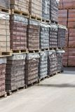 pallets with bricks in the building store. Racks with brick. Masonry, stonework. royalty free stock image