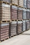 pallets with bricks in the building store. Racks with brick. Masonry, stonework. Several pallets with concrete brick stacked on to stock image