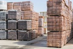 pallets with bricks in the building store. Racks with brick. Masonry, stonework. Several pallets with concrete brick stacked on to stock photo