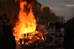 Pallets on fire at a Yellow Vest Demonstration in Paris stock image