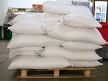 Pallets with sacks of flour, the storage room of the farm stock photography