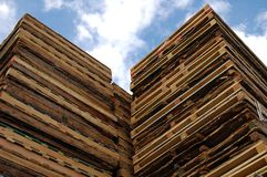 Pallets in the sky. A stack of shipping pallets reaches the sky Royalty Free Stock Image