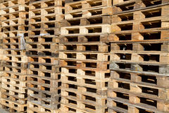Pallets stacked in piles Stock Images
