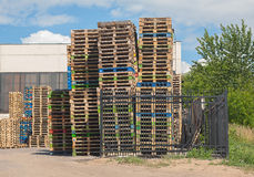 Pallets in stacks outside Stock Images