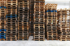 Pallets. Used wooden Euro pallets in distribution warehouse Stock Images