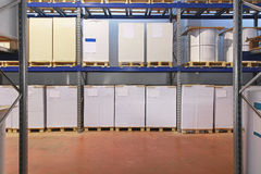 Pallets in warehouse Stock Images