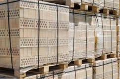 Pallets of yellow brick Stock Photo